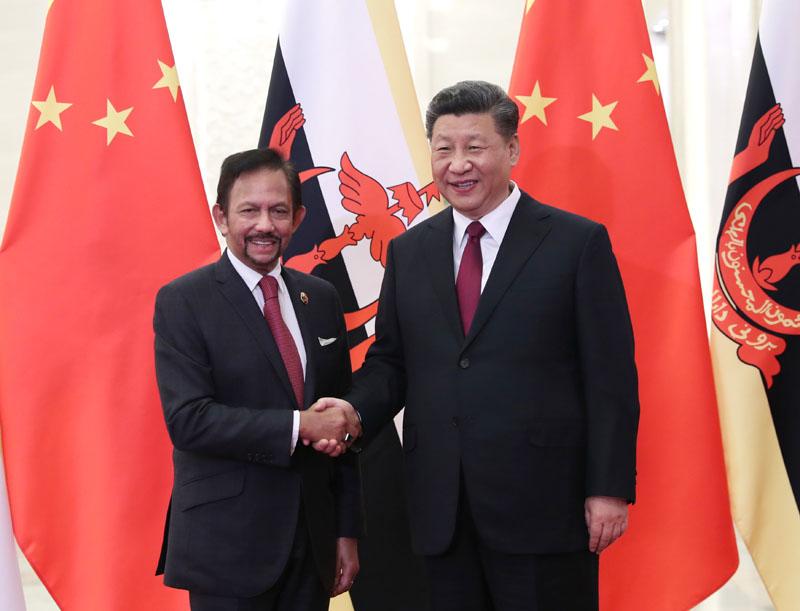 4月26日,国家主席习近平在北京人民大会堂会见文莱苏丹哈桑纳尔。