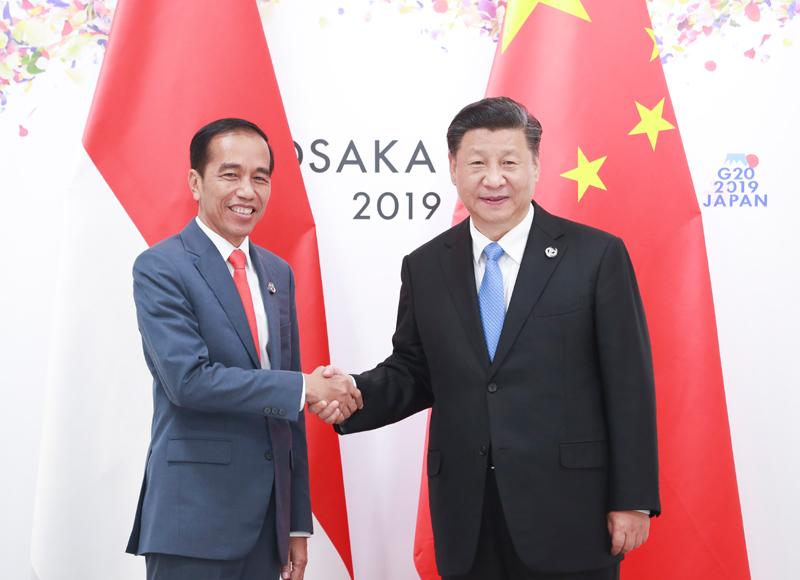 6月28日,国家主席习近平在大阪会见印度尼西亚总统佐科。新华社记者 庞兴雷 摄