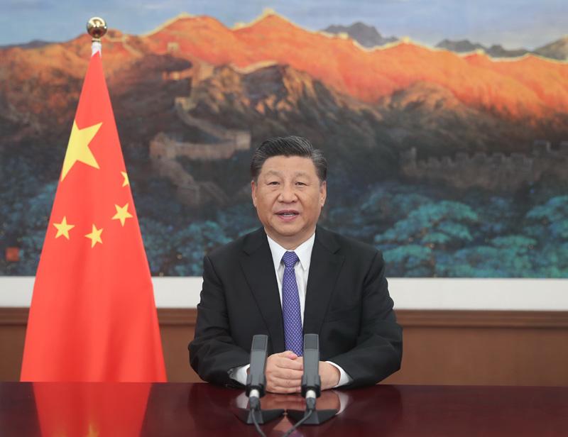 7月28日,国家主席习近平在亚洲基础设施投资银行第五届理事会年会视频会议开幕式上致辞。新华社记者 鞠鹏 摄