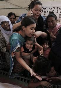 Photo taken on June 19, 2010 shows a family members of a target killing victim mourn during his funeral in Karachi, Pakistan. A surge in killings _ sectarian, political and criminal _ is wracking the economic hub of Karachi. The violence is adding to the problems facing a U.S-allied government at war with Islamist extremists and undercutting confidence in its shaky rule.(AP Photo/Shakil Adil)