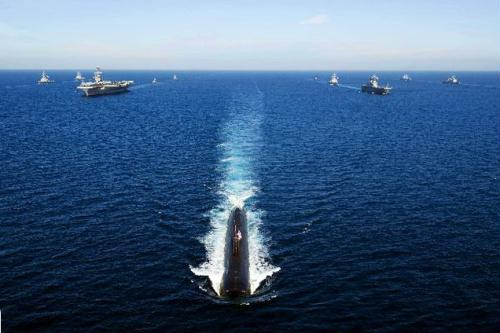 The Los Angeles-class attack submarine USS Tucson (SSN 770, front) is underway ahead of the U.S. nuclear-powered aircraft carrier USS George Washington (3rd L) and South Korean Navy's Landing Platform Helicopter ship Dokdo (3rd R) during the U.S.-South Korea joint naval and air exercise in the open sea east of South Korea July 26, 2010.  (Xinhua/AFP Photo)