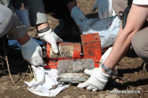 The black-box of a crashed passenger plane is found in Yichun City, northeast China's Heilongjiang Province, Aug. 25, 2010. A passenger plane with 96 people on board crashed late Tuesday night near the Yichun airport. At least 42 people were confirmed dead while the remaining 54 have been rescued and sent to hospitals.(Xinhua/Xing Guangli)