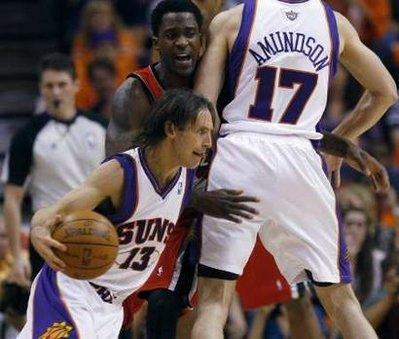 Phoenix Suns' Steve Nash (L) drives around Portland Trail Blazers' Martell Webster (C) as he is boxed out by Louis Amundson during the first half of Game 1 of their NBA Western Conference playoff series in Phoenix, April 18, 2010.REUTERS/Joshua Lott(UNITED STATES - Tags: SPORT BASKETBALL)