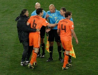 Referee Howard Webb, of England, center, warns Netherlands' Mark van Bommel, second from left, during the World Cup final soccer match between the Netherlands and Spain at Soccer City in Johannesburg, South Africa, Sunday, July 11, 2010. (AP Photo/Michael Sohn)