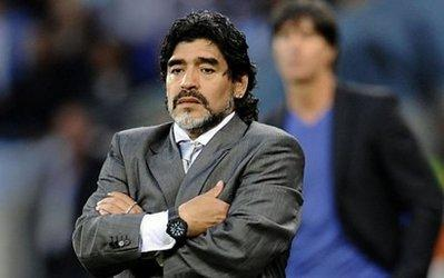 Argentina coach Diego Maradona, pictured on July 3, hinted he may resign as he returned home following his side's World Cup elimination, according to a report from Argentine cable channel Cronica TV.(AFP/File/Daniel Garcia)