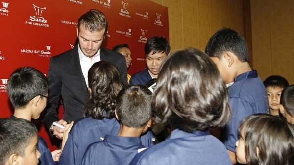 Beckham delights singapore children cctv news cntv english former soccer player david beckham signs autographs during a meet and greet session with students from the guardian academy and the singapore association of m4hsunfo