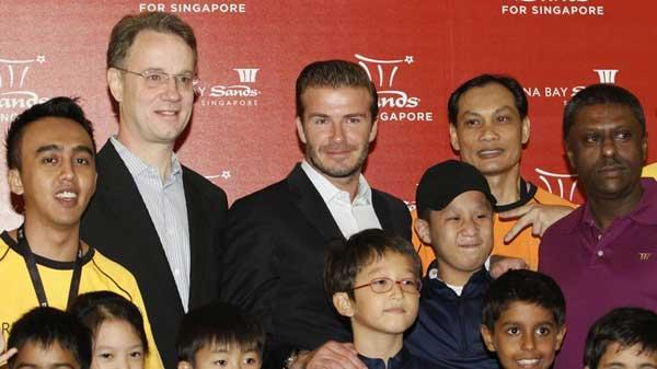 Beckham delights singapore children cctv news cntv english former soccer player david beckham c poses during a meet and greet session with students from the guardian academy and the singapore association of the m4hsunfo