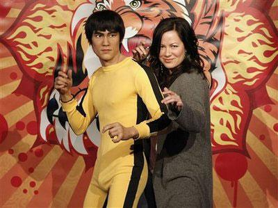In this photo provided by Madame Tussauds Hollywood, Shannon Lee, daughter of the late Bruce Lee poses with a wax figure of her father at the unveiling ceremony of the figure at Madame Tussauds Hollywood in Los Angeles on Thursday, Feb. 11, 2010. (AP Photo/Madame Tussauds Hollywood, Dan Steinberg)