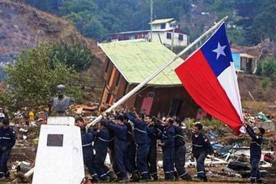Sailors raise a Chilean flag during reconstruction efforts on Juan Fernandez island in southern Chile, Thursday, March 4, 2010. An 8.8-magnitude earthquake struck central Chile on Feb 27, causing widespread damage. (AP Photo)