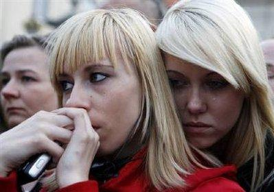 Two girls comfort each other in front of the Presidential Palace in Warsaw's city center April 12, 2010.