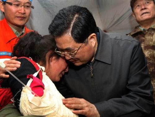 Chinese President Hu Jintao (R front) gives a hug to injured student Zhoema of Tibetan ethnic group during his visit to those injured in the quake receiving treatment at a stadium in the Tibetan Autonomous Prefecture of Yushu, northwest China's Qinghai Province, April 18, 2010. Hu arrived in Yushu Sunday morning to direct relief work. (Xinhua/Lan Hongguang)
