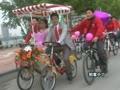 【拍客】百人骑行迎新娘 低碳环保率先行