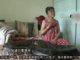 【拍客】夫妻九年养出长达四米蟒蛇 与其同睡一张床