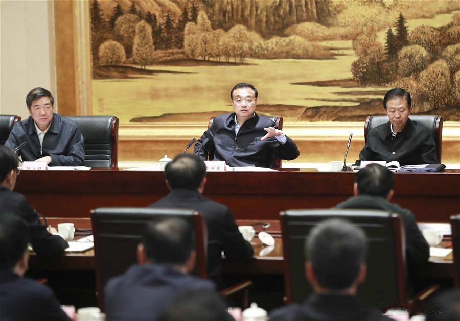 Chinese Premier Li Keqiang, also a member of the Standing Committee of the Political Bureau of the Communist Party of China (CPC) Central Committee, chairs a symposium attended by heads of some provincial governments to analyze the current economic situation in Xi