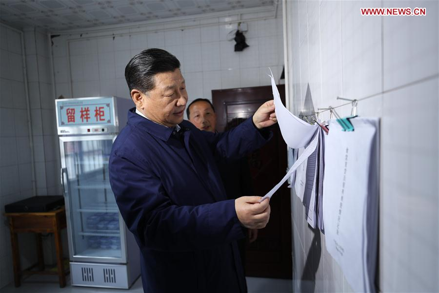 Chinese President Xi Jinping, also general secretary of the Communist Party of China Central Committee and chairman of the Central Military Commission, learns about a mechanism requiring school officials to dine with students at a primary school in Zhongyi Township of Shizhu Tujia Autonomous County, southwest China