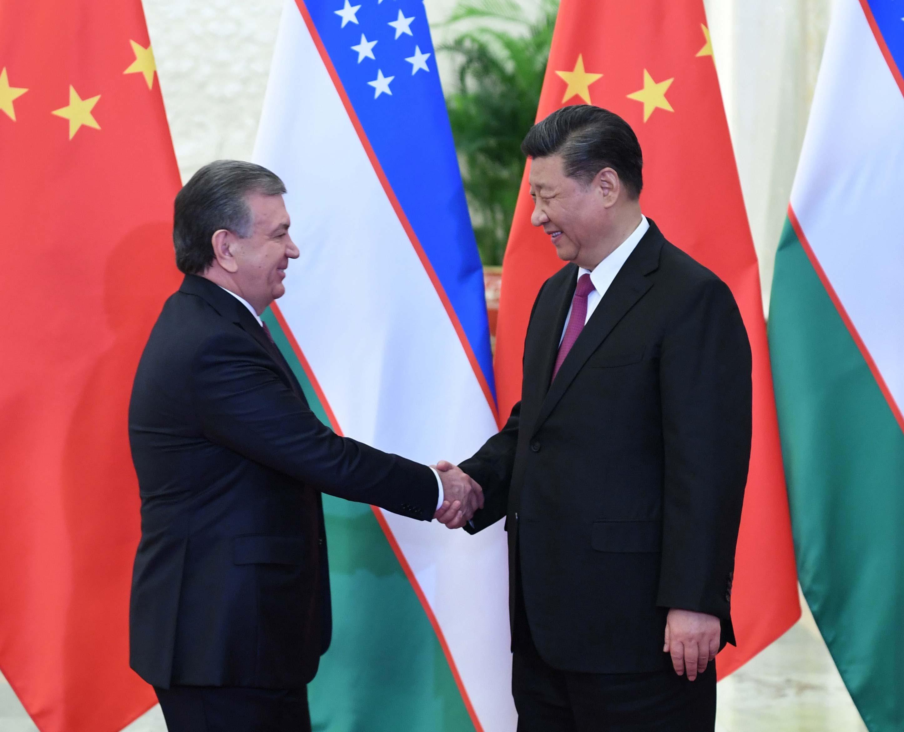 4月25日,国家主席习近平在北京人民大会堂会见乌兹别克斯坦总统米尔济约耶夫。