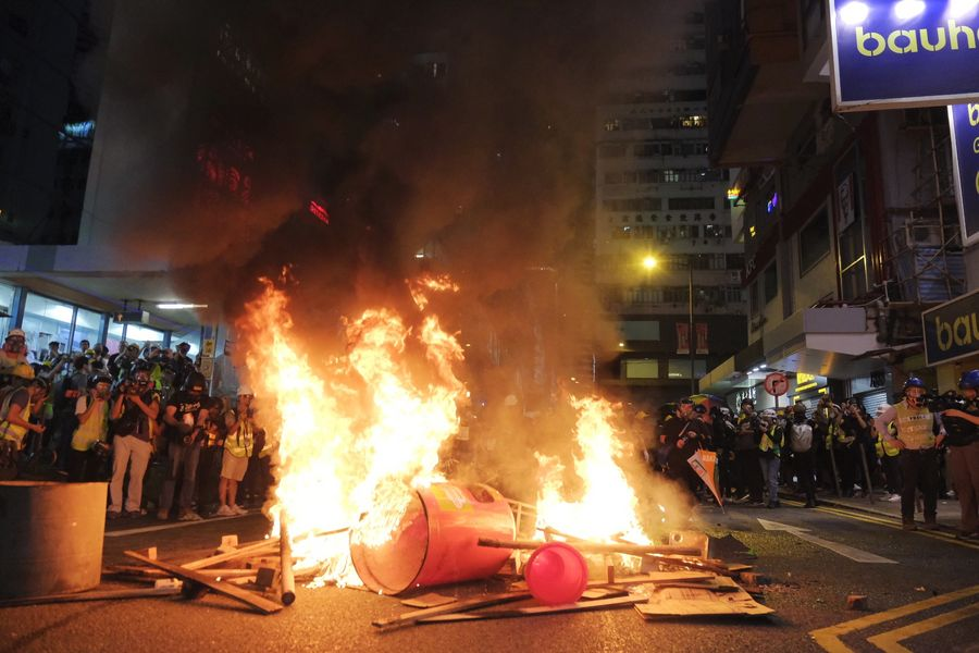 Violent radicals set fires after blocking a road in Causeway Bay, south China