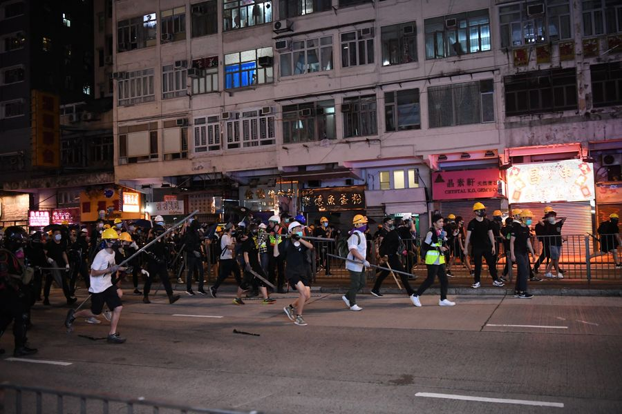 Violent radicals go after a police vehicle in North Point, south China