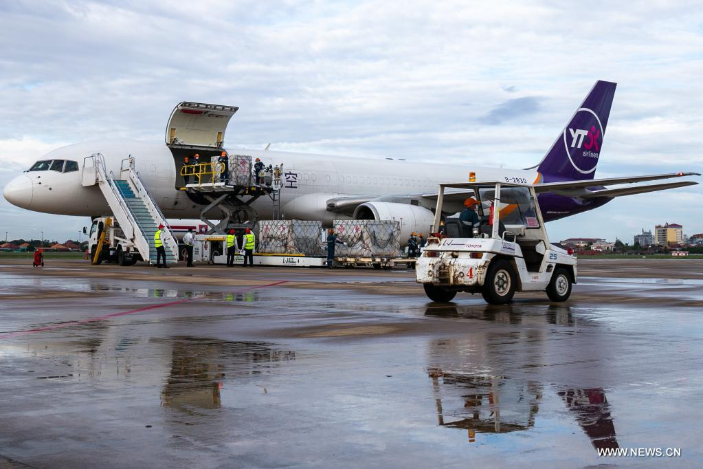 Workers unload China-donated COVID-19 vaccines from a Chinese cargo plane in Vientiane, Laos, on June 14, 2021. A batch of Chinese government-donated Sinopharm COVID-19 vaccines arrived at Wattay International Airport in Laos on Monday with a handover ceremony held upon their arrival.